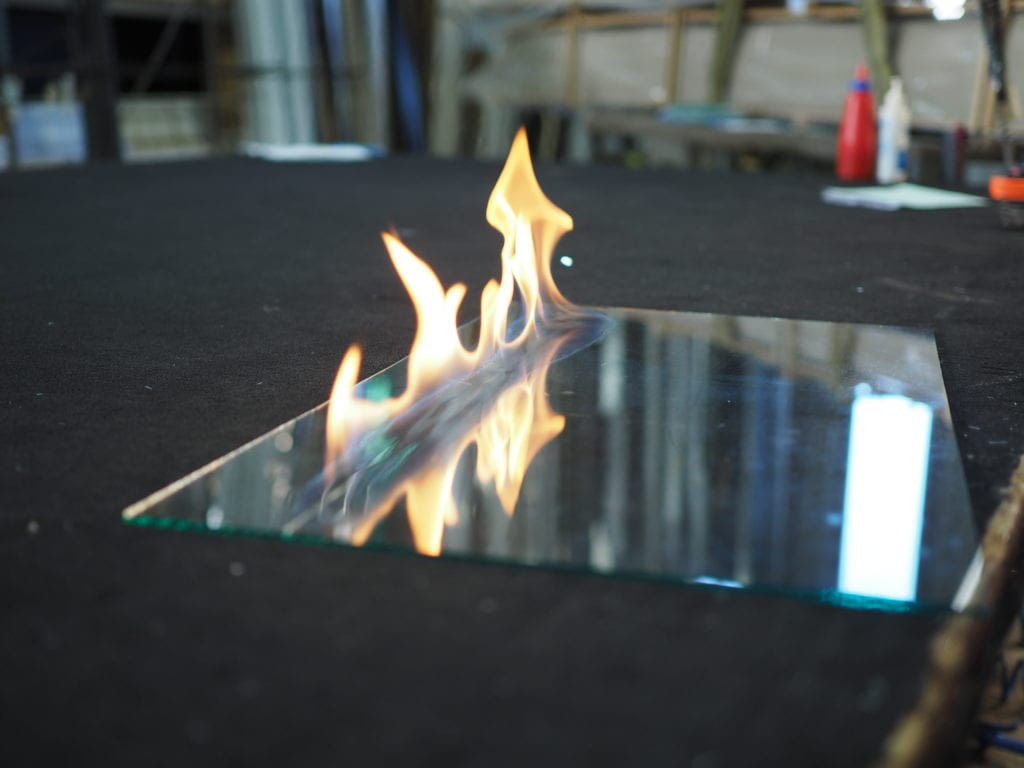 Using flame to cut glass